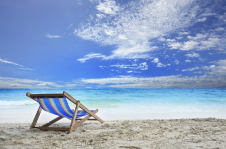 wood chairs deck on white sand beach with clear blue sea water and cloudy sky use for natural haliday vacation destination photo