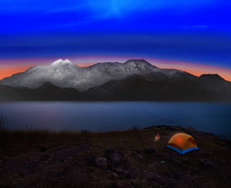 dusky: camping tent with rock and snow mountian scene use for natural adventure journey and heaven destination