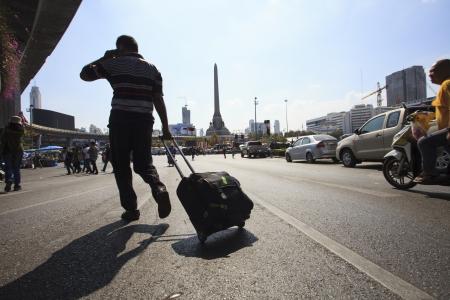 protester: Bangkok Thailand-Jan13- thai government protester mobbing by shutdown bangkok and occupy bangkok campaign  victory monument  heart of bangkok on Jan13,2014 in Bangkok Thailand