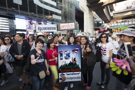 protester: Bangkok Thailand-Jan13- thai government protester mobbing by shutdown bangkok and occupy bangkok campaign wearing  clothes and accessories nation flag color in heart of bangkok on Jan13,2014 in Bangkok Thailand Editorial