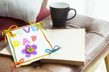 love dad card lying on living room chairs desk photo