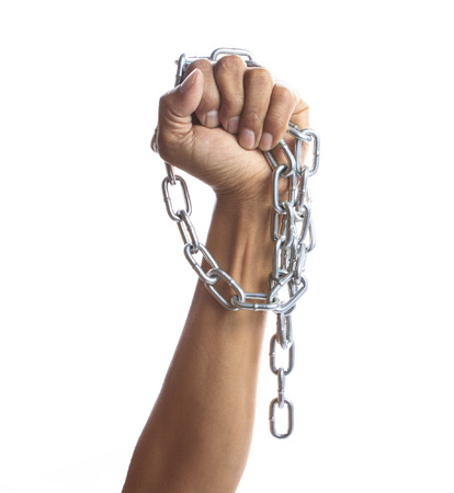 hand chain: hand hold hard shiny metal chain isolated on white background