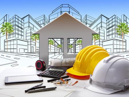 建設業界と不動産や財産の土地開発テーマ用のテーブルの上にエンジニア リング作業ツールと作業テーブルを設計します。