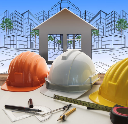 property development: engineer working table with construction industry and engineering working tool on top of table use for real estate and property land development theme