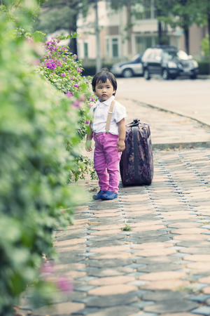 children standing with big suitcase on road side Stock Photo - 26137511