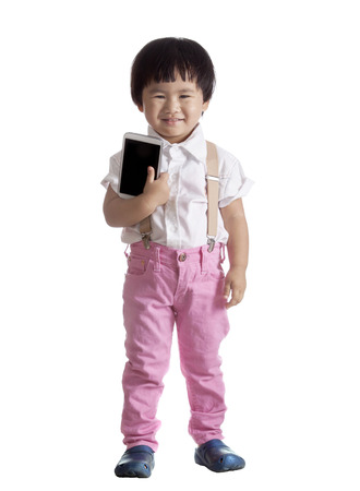 young asian kid and smart phone computer tablet in hand show empty touching screen isolated white background  Stock Photo - 26138404