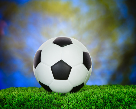 soccer football on green grass field use for sport competition background photo