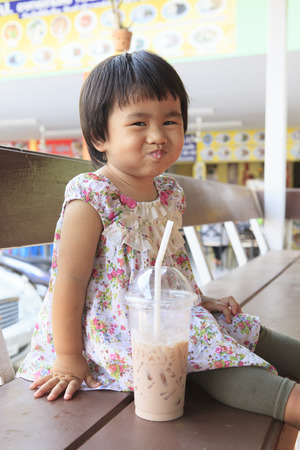 children and chocolate milk in plastic bottle use for healthy food and plastic container bottle  photo