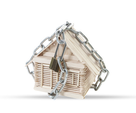 seem: chain and lock locked on wood model house seem abstract protection home from bad situation and multipurpose  Stock Photo