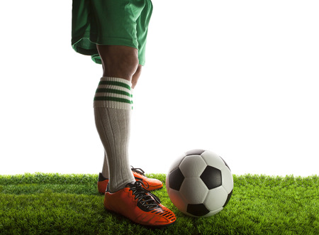 legs of football player ,soccer player and soccer ball isolated white background with copy space use for sport and athletic topic  photo