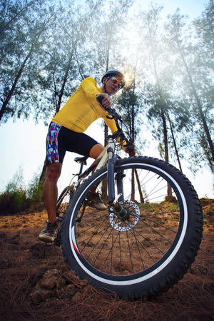 young man riding mountain bike mtb in jungle track use for sport extreme adventure healthy and holiday activities life style  photo