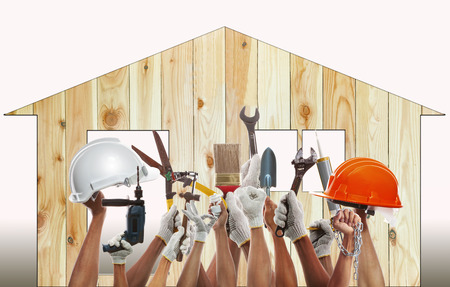 home and hand rising diy tool equipment against wood house photo
