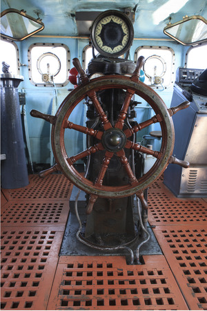 old wood boat steering wheel in military war ship  photo