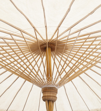 under view of hand craft clothes umbrella structure of nothern thailand made from bamboo wood thai original tradition photo
