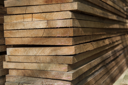 close up pile wood texture stack in factory  photo
