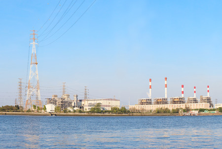river scape: Thermal  Power  Plant beside river side location use for industry and power engergy producing and  multipipurpose topic