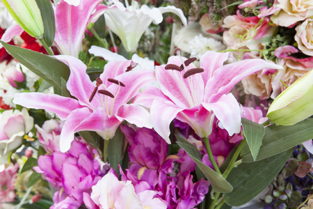 artificial pink lilly flowers bouquet arrangement for decorated and use as background backdrop photo
