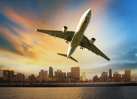 airplane take off: passenger plane flying above urban scene use for convenience air transport and logistic cargo by air transportation