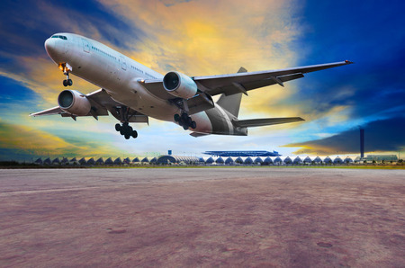 runways: passenger jet plane landing on air port runways against beautiful dusky sky use for travel business and air transport ,cargo logistic service industry