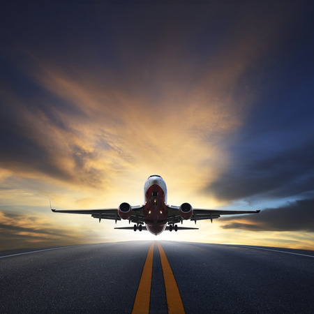 airplane landing: passenger plane take off from runways against beautiful dusky sky with copy space use for air transport ,journey and traveling industry business