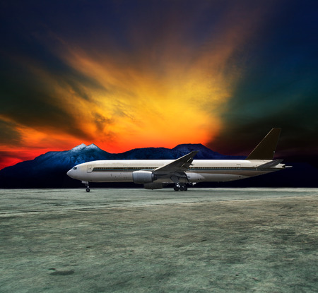 jet plane flying over runways and beautiful dusky sky with copy space use for air transport ,journey and traveling industry business  photo