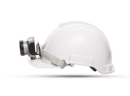side view of white mining safety helmet with light lamp isolated background photo