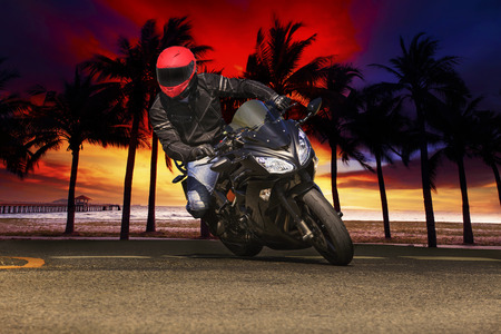 dusky: young man riding big bike motorcycle on asphalt roads against beautiful dusky sky use for sport leisure and male activities theme