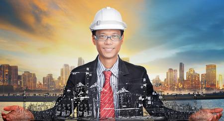 ingeniero civil: ingeniero joven y su utilización proyecto de desarrollo urbano para la construcción y indusky tema de desarrollo del suelo urbano Foto de archivo
