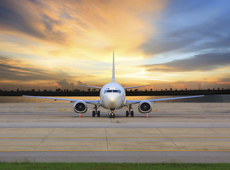runways: passenger jet plane parking on airport runways use for business transport and cargo logistic background Stock Photo