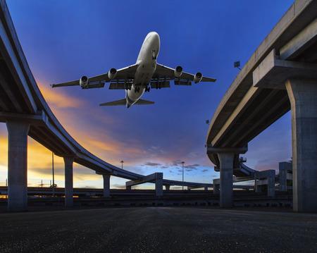land transportation: passenger jet plane flying over transport land bridge use this image for air and land transportation theme