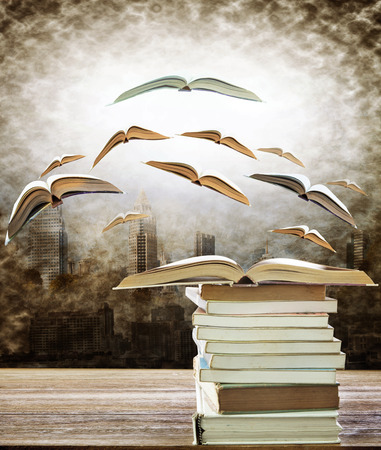 abstract of open book on stack and flying book to the light over urban scene use for idea ,creative and education topic Stock Photo