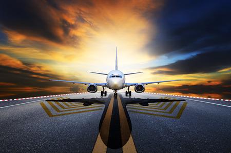 runways: passenger jet plane preparing to take off from airport runways against beautiful dusky sky Stock Photo