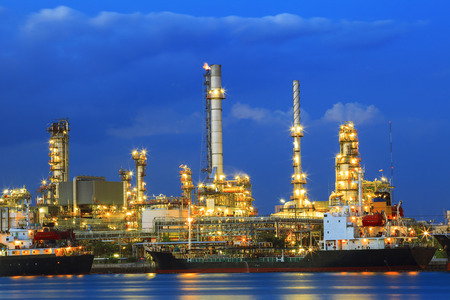 energy use: heavy industry land scape of petrochemical refinery plant  with beautiful lighting against blue sky twilight on dusky time use for fuel energy  industrial  theme