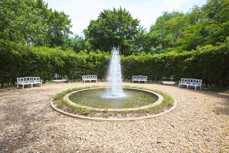 symetric: water fountain in english garden use for multipurpose background,backdrop