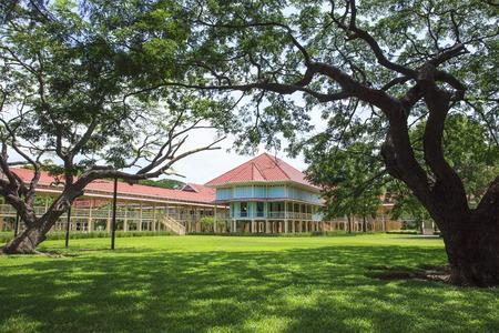 dazzle: beautiful landscape scene of Marukhathaiyawan Palace most dazzle wood palace house in cha-am petchaburi southern of thailand