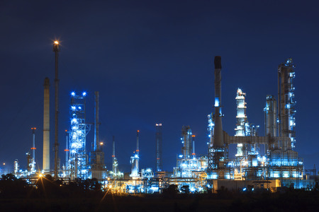 land pollution: lighing landscape of oil refinery petrochemical in heavy industry estate use for power and energy topic