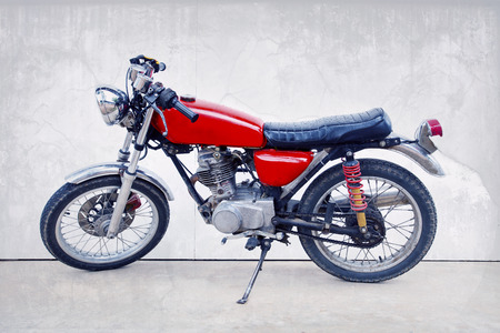 vintage color style of old classic motorcycle standing against white background photo