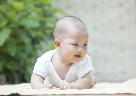 close up face of smiling baby lying on soft bed at home terrace use for infant and newborn,kid and motherhood topic  photo