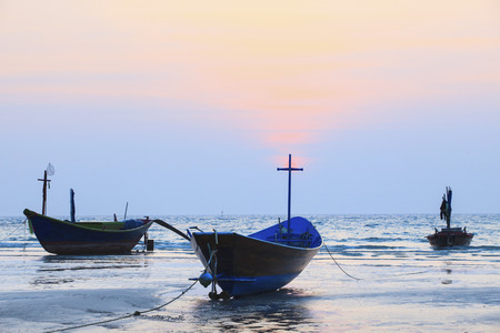 fishery: crosses wood and thai fishery boat on sea beach against beautiful dusky sky use for natural background  Stock Photo