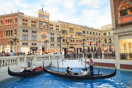 Shoping: COTAI STRIP, MACAU, CHINA-AUGUST 22 visitor on gondola boat in Venetian Hotel  The famous shopping mall, luxury hotel important landmark and the largest casino in the world on august 22,2014 in Macau China