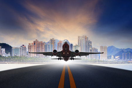 runways: jet plane take off from urban airport runways use for air transportation and business cargo logistic industry Stock Photo