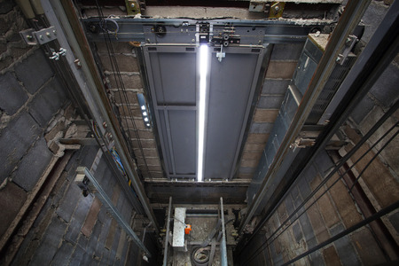 inside of roping Elevator, Lift box builting in high building show strong structure use for engineering construction and industrial object