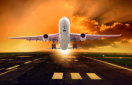 passenger plane take off from runways against beautiful dusky sky with copy space use for air transport ,journey and traveling industry business