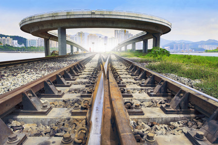 infra construction: railways track and bridge cross over with urban scene behind use for land and town development and infra structure construction and land transport government service