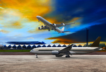 runways: jet plane flying over runways and beautiful dusky sky with copy space use for air transport ,journey and traveling industry business