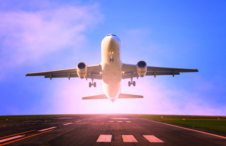 airplane take off: passenger jet plane flying from airport runway use for traveling and cargo ,freight industry topic