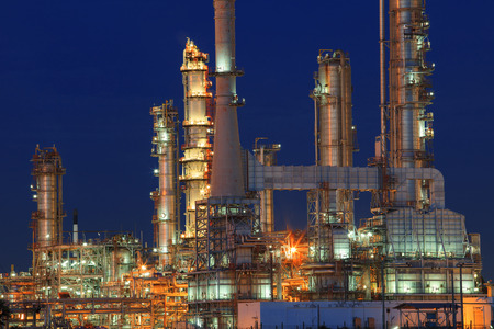 oil refinery plant in petrochemical industry estate at night time with blue sky background