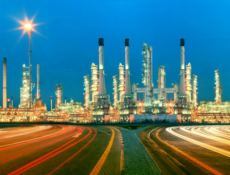 beautiful lighting of oil refinery plant in  heav petrochemicaly industry estate use for power ,energy and petroleum industrial topic Imagens