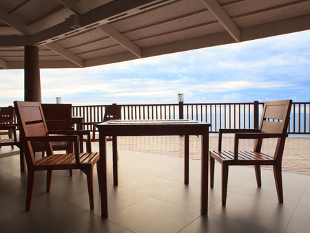 out door: wood table and wooden desk in pavilion terrace against beautiful sky at sea side location