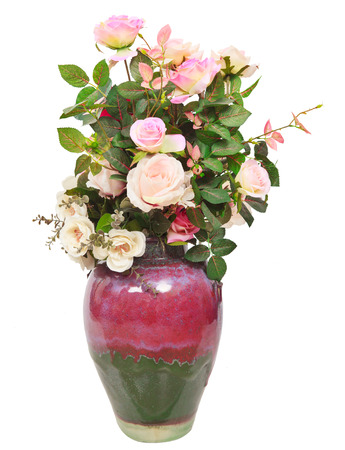 ceremic: artificial roses flowers bouquet in ceramic jug isolated white background use for decorated in home interior Stock Photo